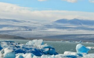 15705197 - ice lagoon and iceberg lake and person